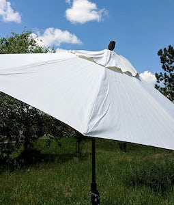 TREASURE GARDEN 9 FTCOLLAR TILT UMBRELLA IN VANILLA WITH A BRONZE STEM