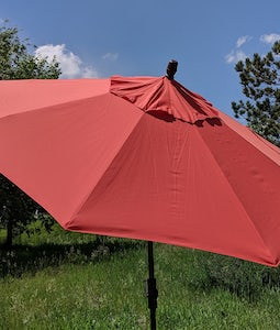 TREASURE GARDEN 9FT COLLAR TILT UMBRELLA IN SUNSET WITH BRONZE STEM